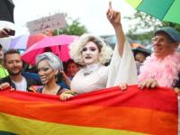 People celebrate in front of Germany's lower house of parliament Bundestag after the delegates voted on legalising same-sex marriage, in Berlin, Germany June 30, 2017. REUTERS/Hannibal Hanschke