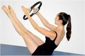 the Pilates circle (arms forward) work in the teaser position