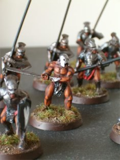 An Uruk Hai Bezerker stands ready to strike his foes