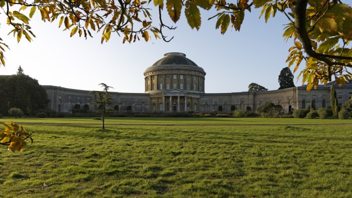 View of the North Front of Ickworth, Suffolk, framed by autumn leaves.