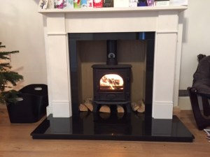 Flat Vic limestone surround with Gazco Stockton 5 gas stove.