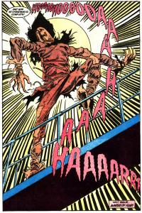 Scarecrow celebrates having Batman at his mercy.