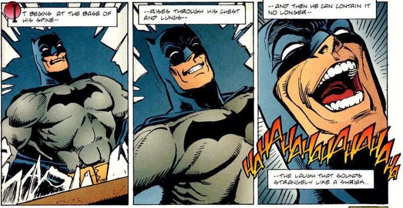 Batman breaks out in laughter.