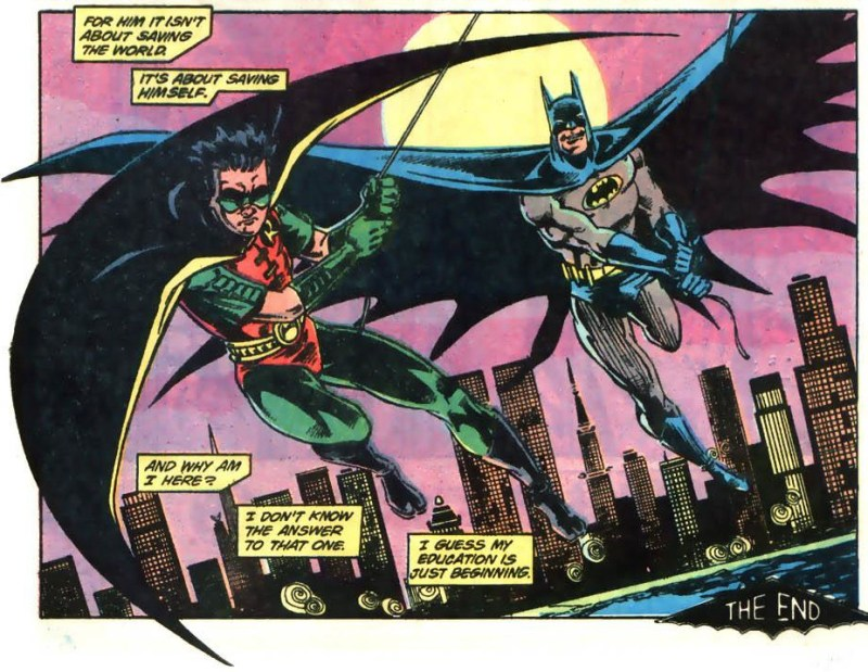Batman and Robin swing off into the night.