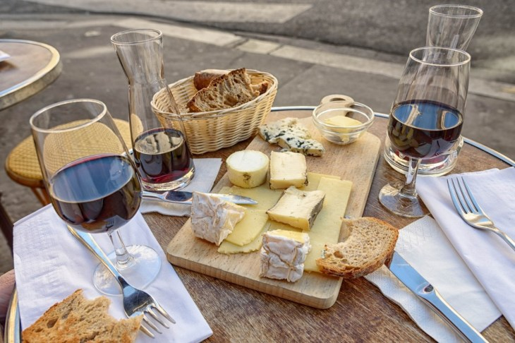 This image has an empty alt attribute; its file name is wine_cheese_bread_caf_paris_france_travel_meal-862296d.jpg