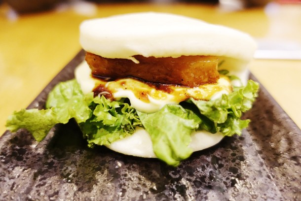 Steamed bun with braised pork belly, lettuce, and Japanese mayo