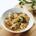 Pork Dumplings with Spicy Peanut Sauce