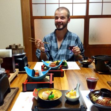 Karl having dinner at Minshuku Tsugizakura in Chikatsuyu | Gay Couple Pilgrimage Kumano Kodo Japan © CoupleofMen.com