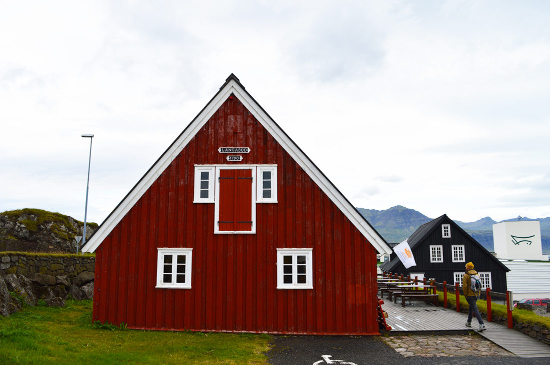 Red, traditional trading house Langabúð | Gay Couple Road Trip East Iceland © Coupleofmen.com