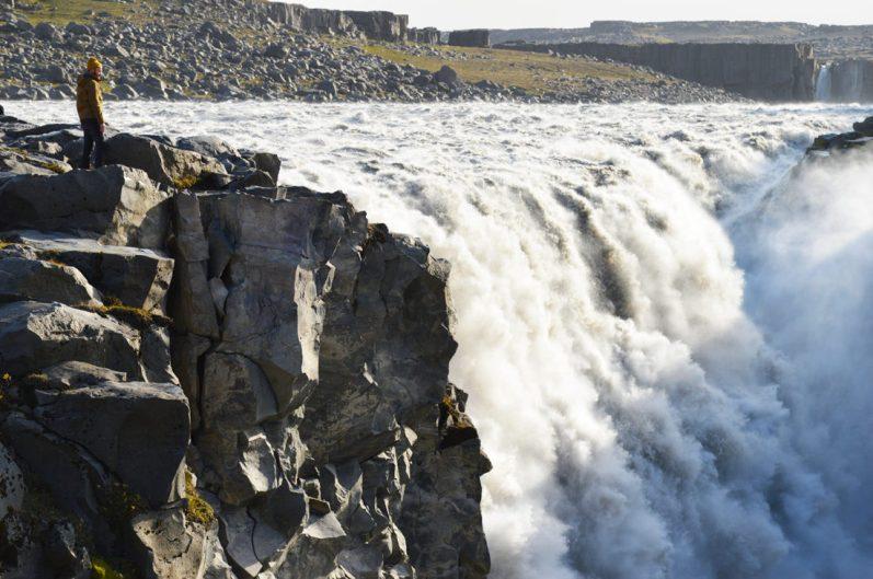 Daan overlooking Dettifoss Waterfall | Gay Couple Road Trip East Iceland © Coupleofmen.com