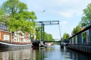 | Gay Couple Rental Canal Boat Tour Amsterdam © CoupleofMen.com