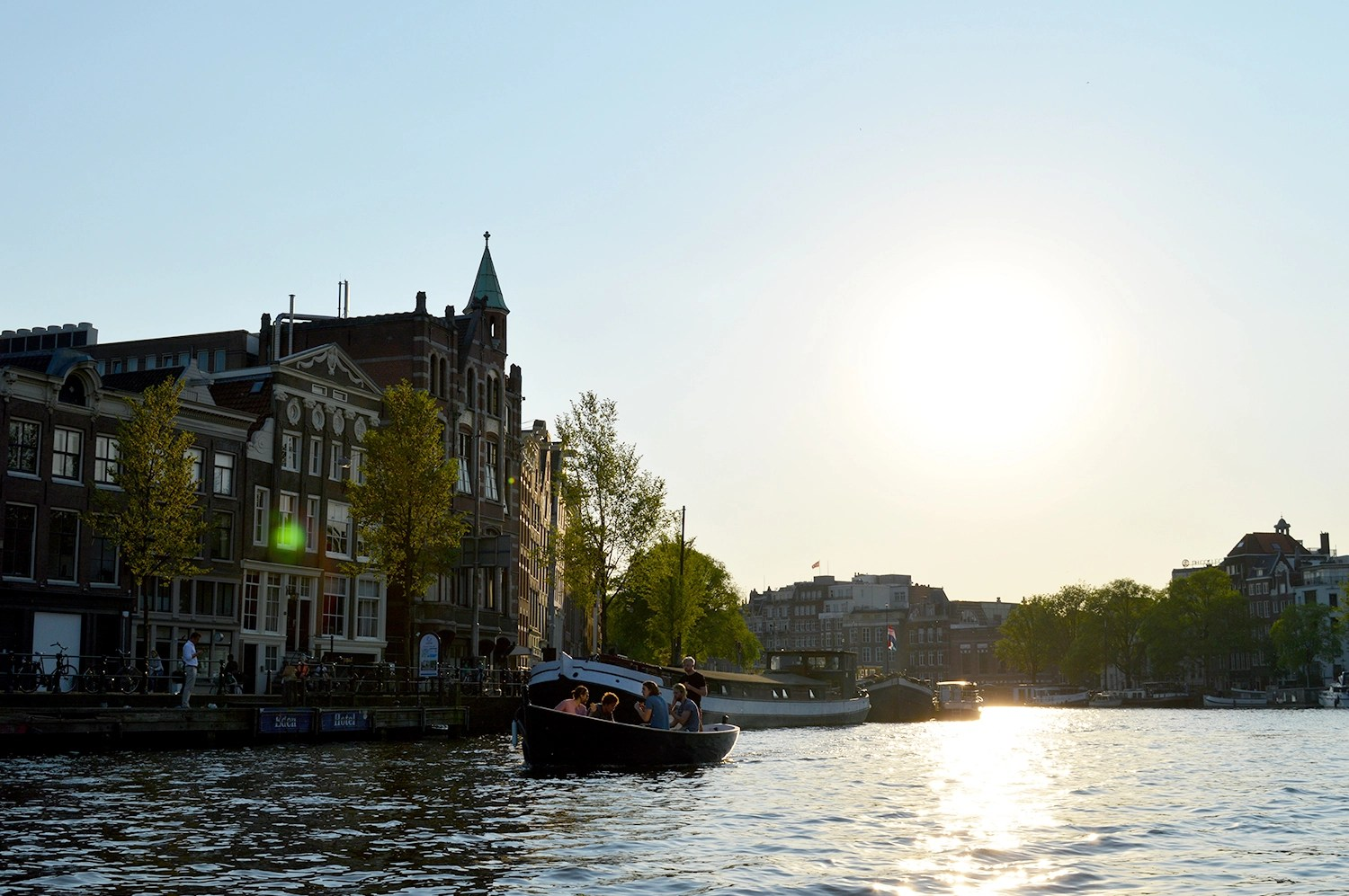 Karl & Daan enjoying the summer on the Amstel River | | Gay Couple Rental Canal Boat Tour Amsterdam © CoupleofMen.com