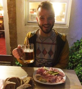 Gay Travel Prague Schwuler Reiseführer Prag Karl loves his meat plate & Czech Beer Café Domeček | Gay Couple City Weekend Prague © CoupleofMen.com