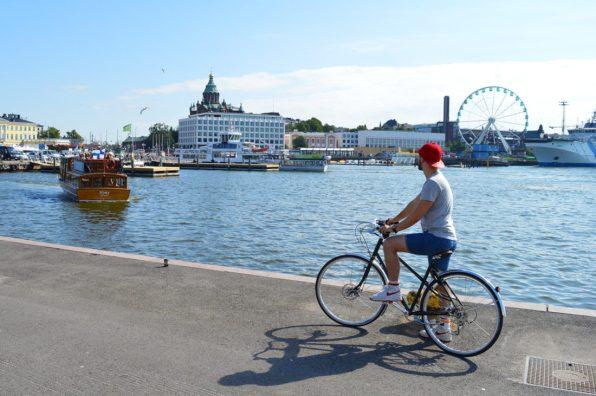 Karl is biking the Finnish capital Helsinki | Gay Couple City Weekend Helsinki Finland © Coupleofmen.com