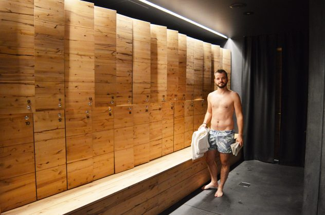 Karl in the men's changing rooms at Sauna Löyly | Gay Couple Finnish Design Sauna LÖYLY Helsinki © CoupleofMen.com