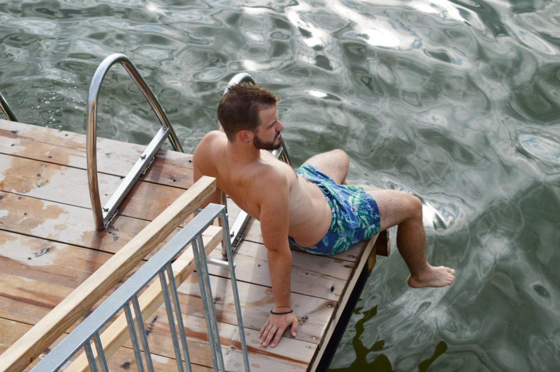 Karl taking in swim in the Finnish bay behind the Sauna Löyly   Gay Couple Finnish Design Sauna LÖYLY Helsinki © CoupleofMen.com