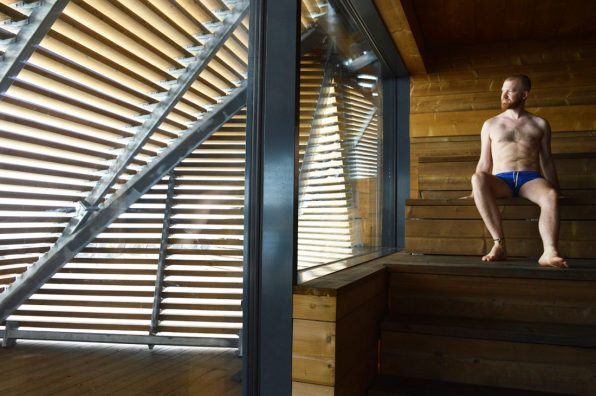 Daan enjoying the heat of the Sauna Löyly | Gay Couple Finnish Design Sauna LÖYLY Helsinki © CoupleofMen.com
