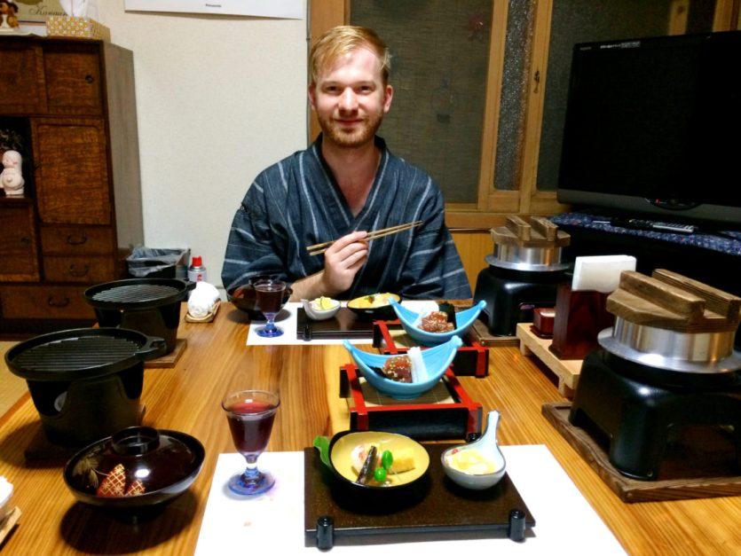 Daan having dinner at Minshuku Tsugizakura in Chikatsuyu | Gay Couple Pilgrimage Kumano Kodo Japan © CoupleofMen.com