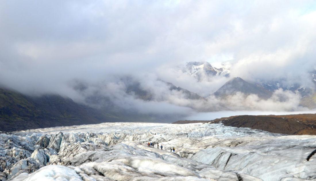 Gay Couple hiking Svínafellsjökull Glacier