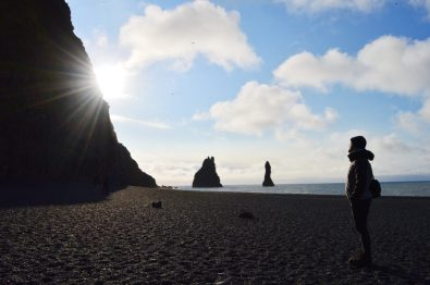 Daan walking along the Black Beaches in South Iceland | Gay Couple exploring South Iceland Vík Black Beach © CoupleofMen.com
