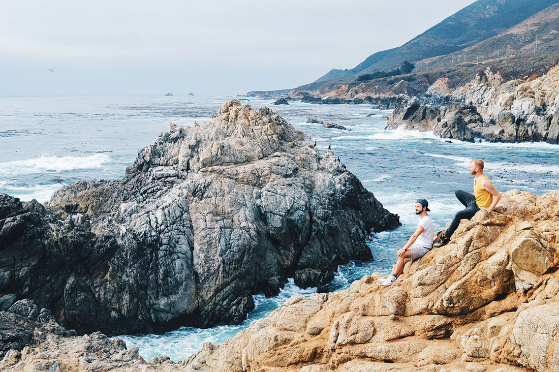 Gay Couple sitting at the coast Enjoying the Pacific Highway No 1 | Road Trip USA Highlights American South West © CoupleofMen.com