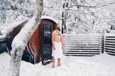 Naked Daan in fresh poweder snow to cool down after Sauna | Slumber Wine Barrel Taufsteinhütte © Coupleofmen.com