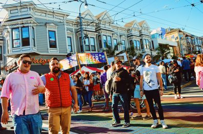 Karl standing on the permanent rainbow crosswalk | Our Photo Story Castro Street Fair San Francisco © CoupleofMen.com