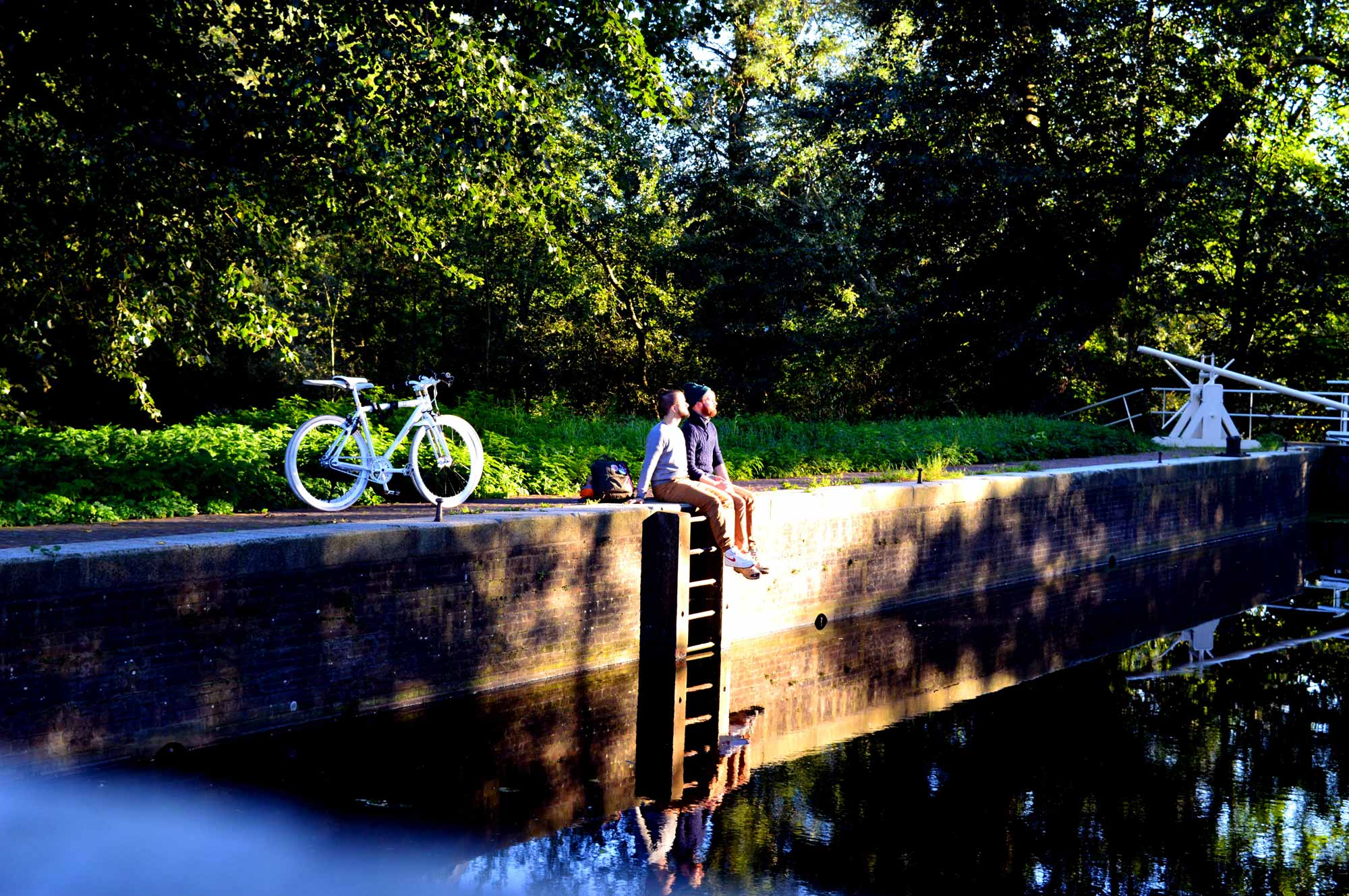 Gay Couple Biking Trips Amsterdam Forest © CoupleofMen.com