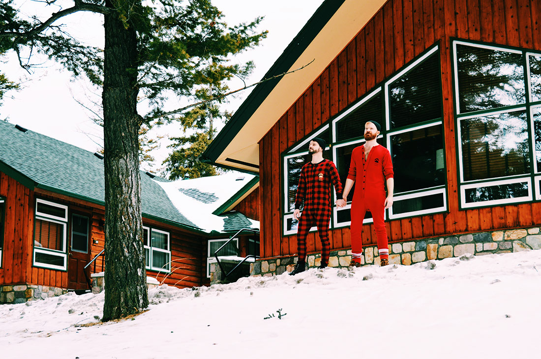 Hand in Hand in our Canadian Onsies in Jasper National Park © Coupleofmen.com