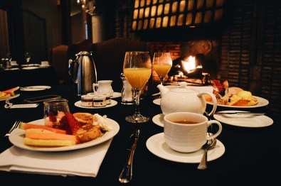 Breakfast at Rimrock next to the fire place | Gay-friendly Fairmont Palliser Hotel Downtown Calgary © CoupleofMen.com
