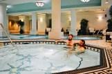 Karl & Daan having a swim at Gay-friendly Fairmont Palliser Hotel Downtown Calgary © CoupleofMen.com