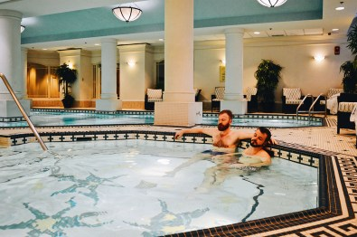 Karl & Daan having a swim at Gay-friendly Fairmont Palliser Hotel Downtown Calgary © CoupleofMen.com