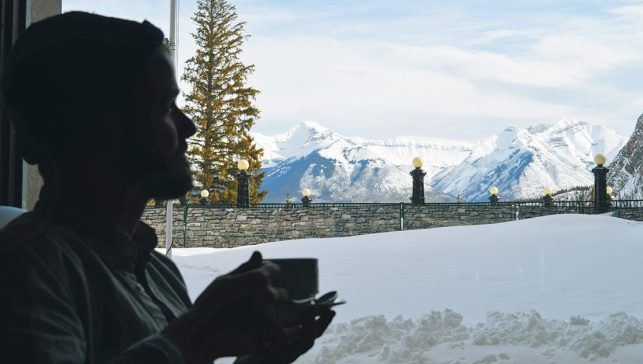 Karl having coffee enjoying the Mountain View | Fairmont Banff Springs Castle Hotel Gay-Friendly © CoupleofMen.com