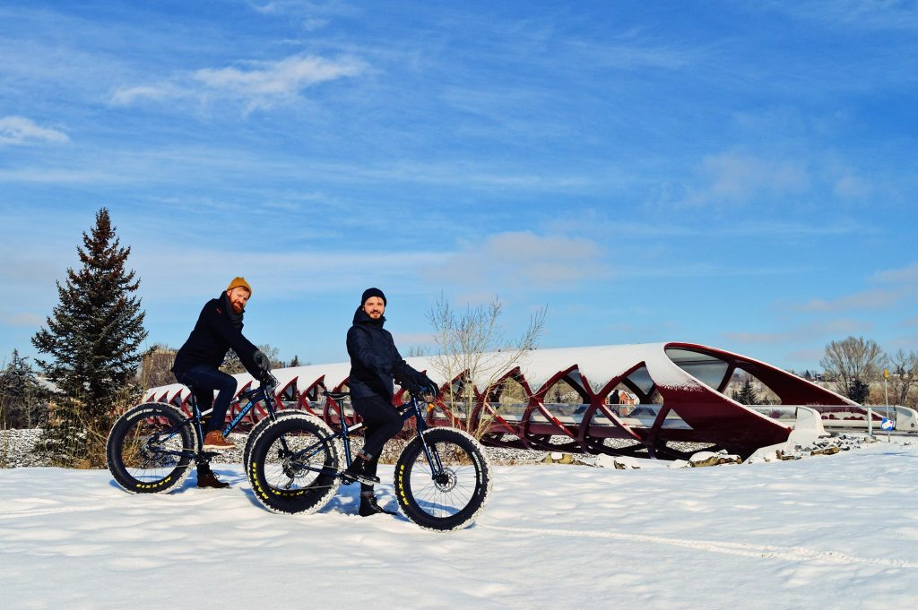 Karl & Daan in front of the Red Peace Bridge by Calatrava | Fat Tire Biking Calgary Nomad Gear Rentals © CoupleofMen.com