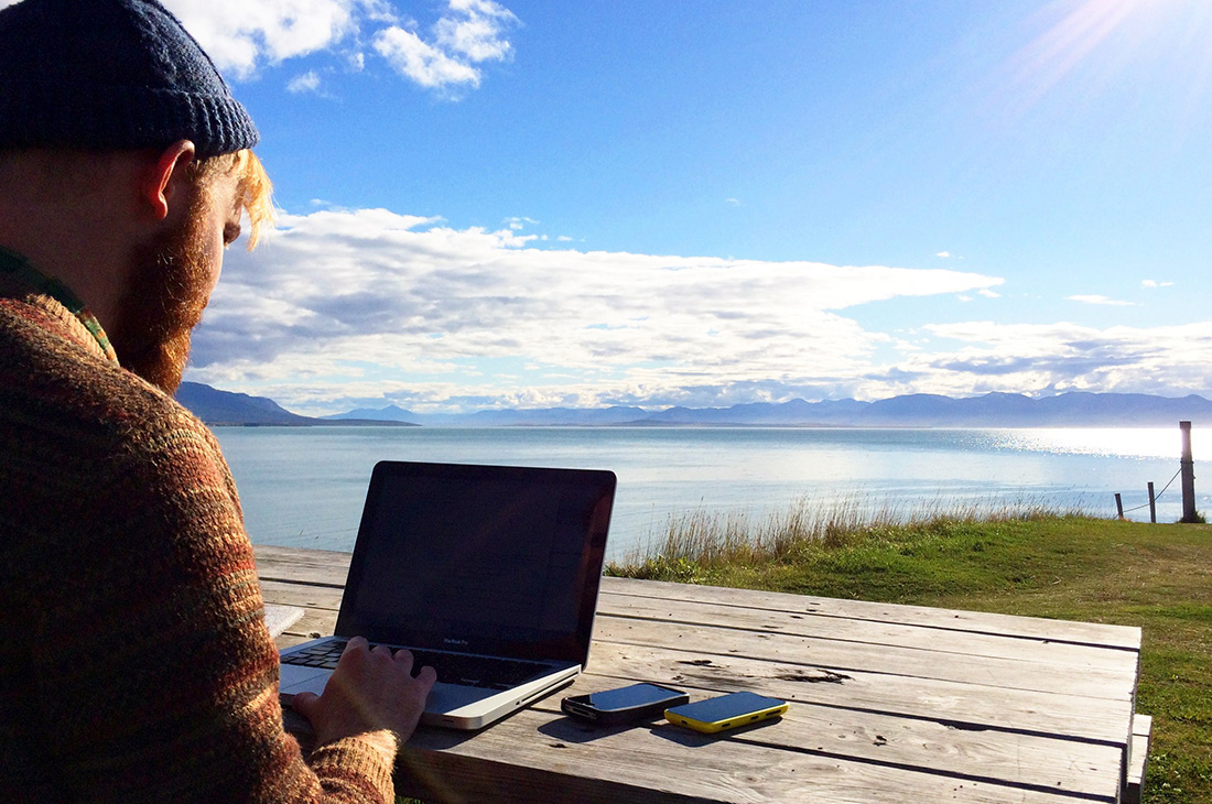 Daan working at the Icelandic Coast | Road Trip Adventure Iceland Gay Couple Insider Tips © CoupleofMen.com