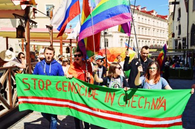 "Self-made banner ""Stop Genocide in Chechnya"" | Baltic Pride 2017 Tallinn Best Powerful LGBTQ Photos © CoupleofMen.com"