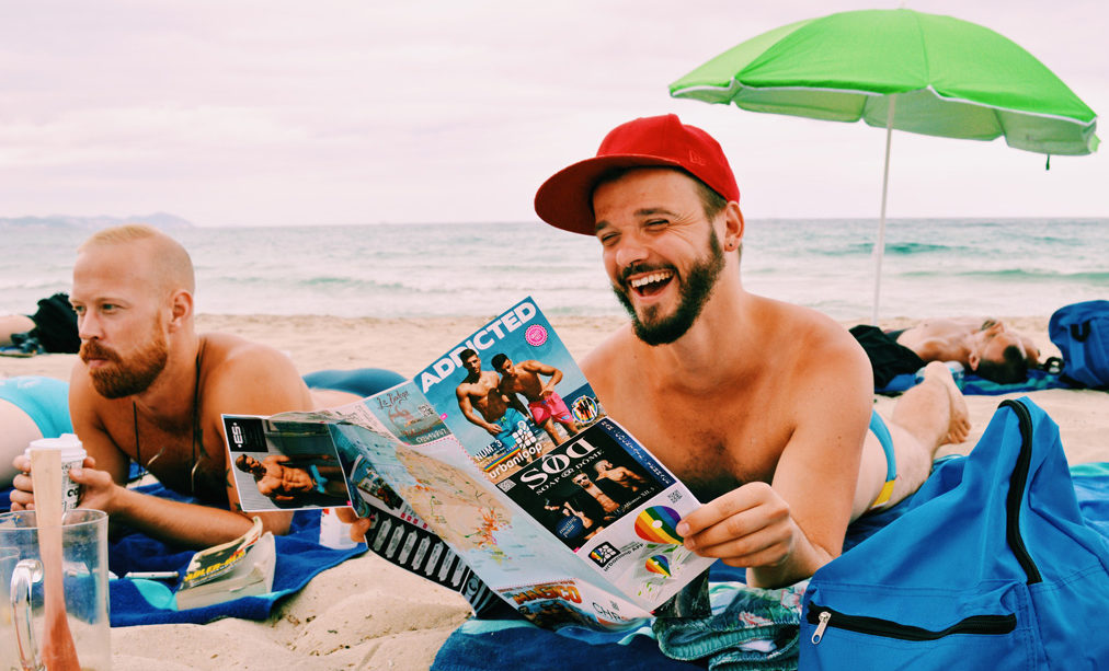 Ibiza Gay Travel Tips Gay Travel Ibiza Quality time in the white Sand of Es Cavallet Beach | Gay Couple Travel Gay Beach Ibiza Town Spain © CoupleofMen.com