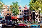 Gay Fahrradtour Amsterdam Muiden Pampus Grachten houses in Amsterdam | Gay Couple Biking Tour Fort Island Pampus © CoupleofMen.com