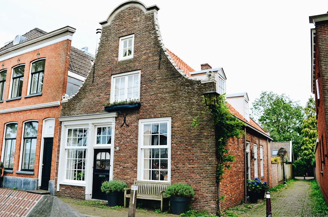 Dutch buildings in Muiden | Gay Couple Biking Tour Fort Island Pampus © CoupleofMen.com