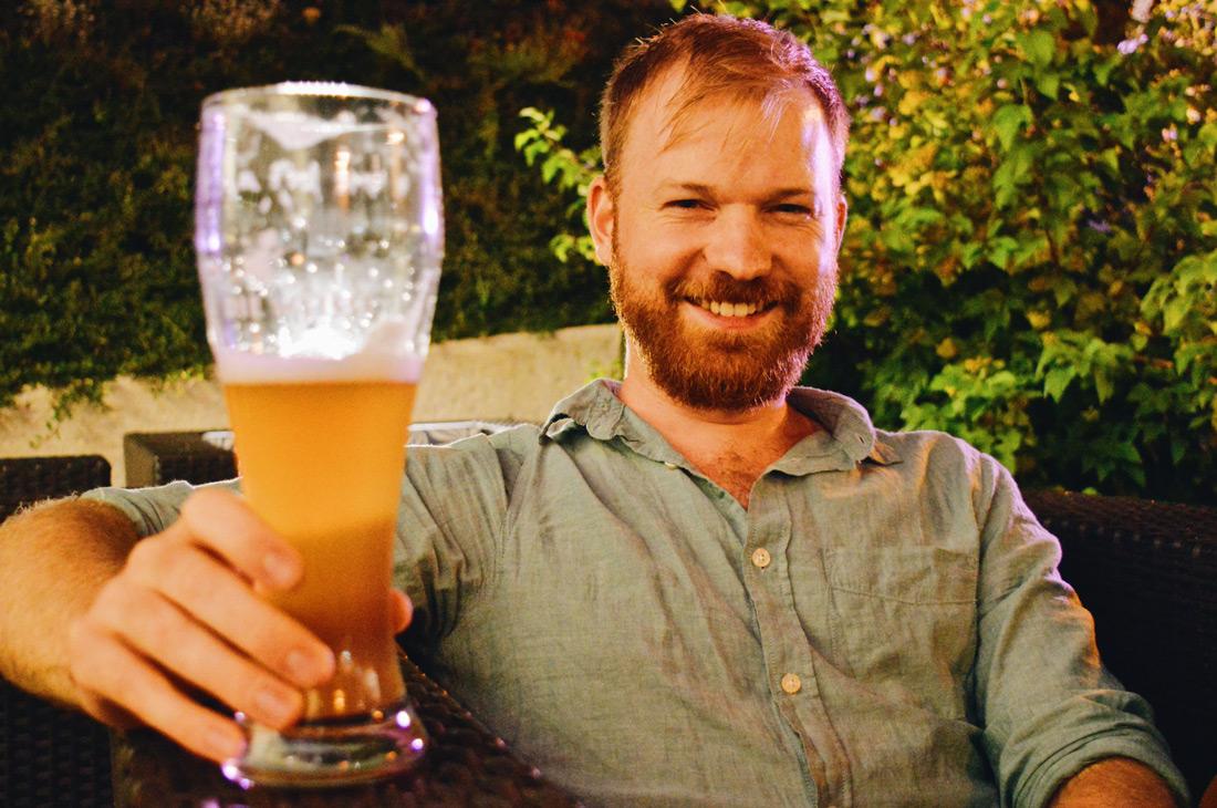Daan love a real big Austria beer! | ROCKET ROOMS Velden Wörthersee gay-friendly © CoupleofMen.com