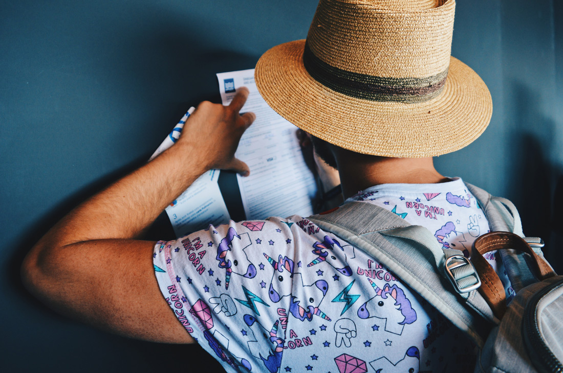 Boarding procedure: Karl filling in forms | Gay Couple Travel Diary The Cruise 2017 © CoupleofMen.com