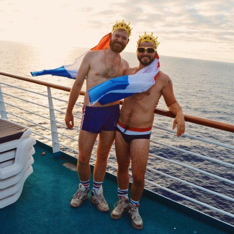 Gay Travel Blogger with Dutch Flags and the sunset | Where are you from Party The Cruise 2017 © CoupleofMen.com