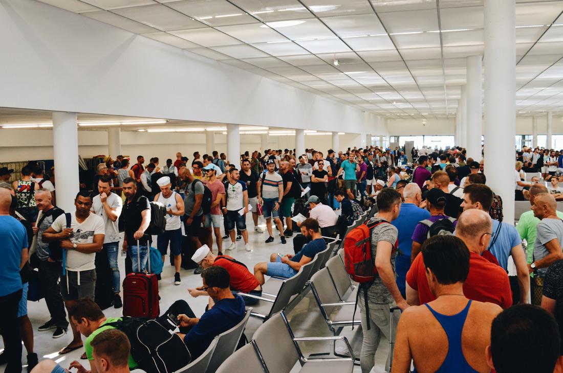 What a queue due to system failure at the terminal © CoupleofMen.com