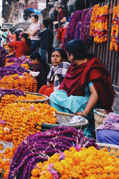 Women selling flower coronals in Kathmandu | Gay Travel Nepal Photo Story Himalayas © Coupleofmen.com