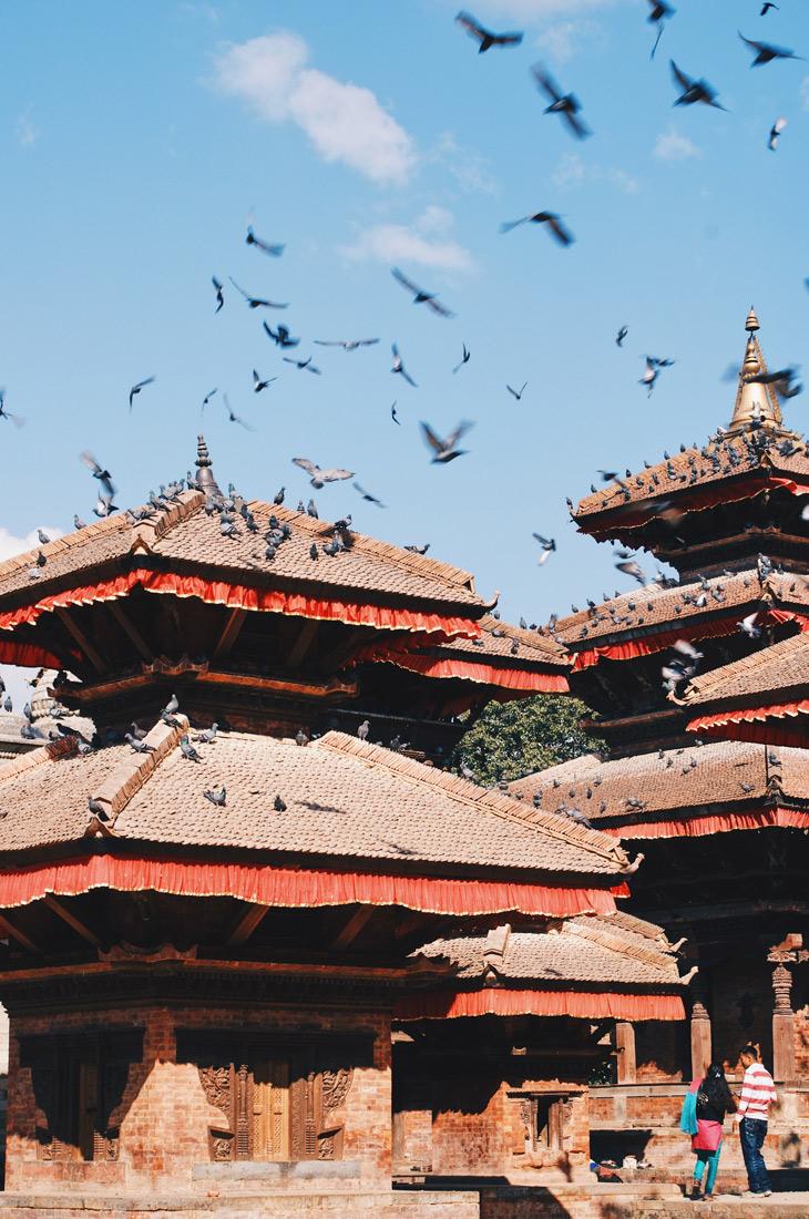 Flying pigeons over the roof tops of Hanumandhoka or Hanuman Dhoka on Durbar Square | Gay Travel Nepal Photo Story Himalayas © Coupleofmen.com