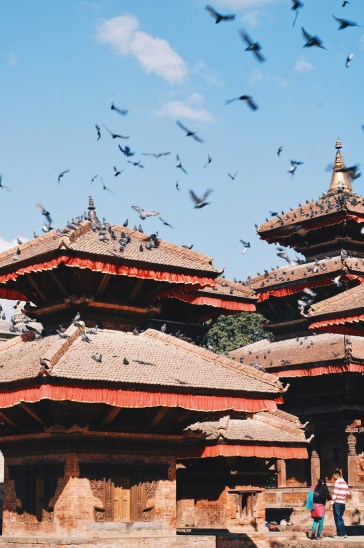 Flying pigeons over the roof tops of Hanumandhoka or Hanuman Dhoka on Durbar Square | Gay Travel Nepal Photo Story Himalayas © Coupleofmen.com