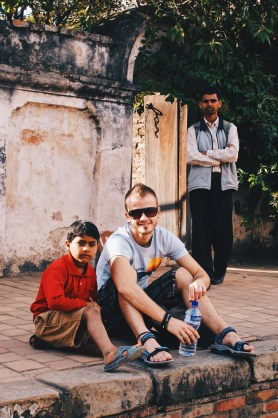 Karl and his new friend sitting in the backyard of the Royal Palace of Bhaktapur   Gay Travel Nepal Photo Story Himalayas © Coupleofmen.com