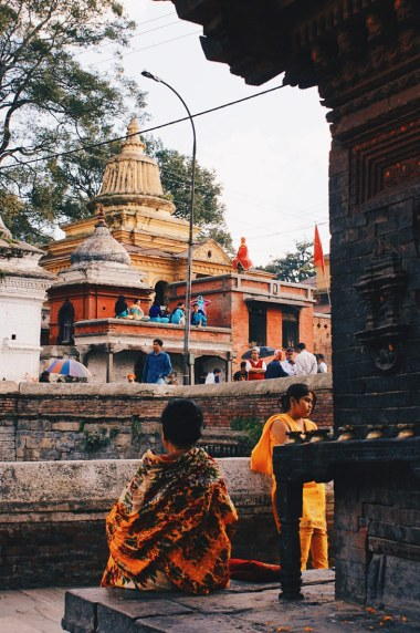 Praying woman at Temple Pashupatinath | Gay Travel Nepal Photo Story Himalayas © Coupleofmen.com