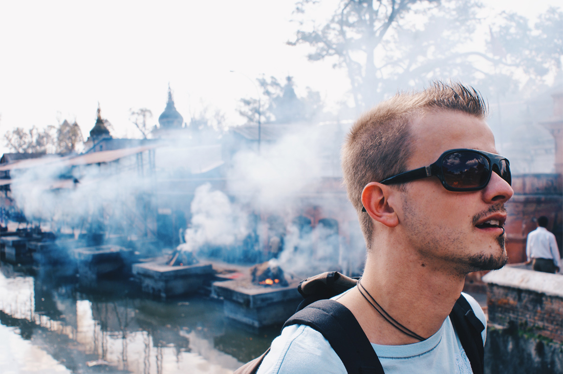 Karl overlooking the mystical environment of the cremation fires at River Bagmati | Gay Travel Nepal Photo Story Himalayas © Coupleofmen.com
