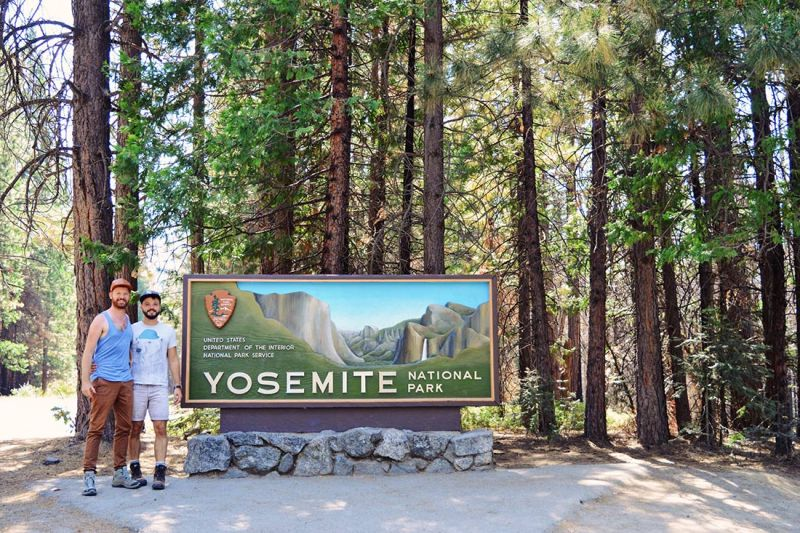 Happy to be here: Selfie at Yosemite National Park sign © CoupleofMen.com